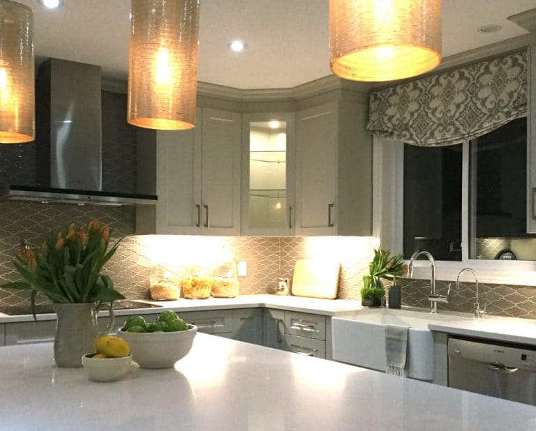Kitchen with yellow hanging lights over island