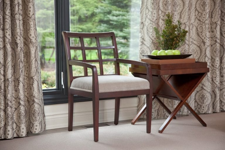 Lattice back wood chair with velvet fabric, damask silk drapes and wood folding side table