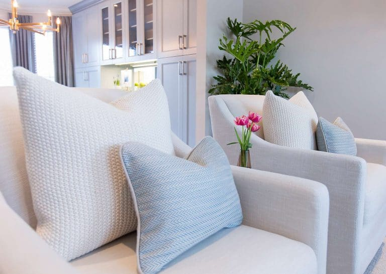 Linen grey armchairs with blue chevron upholstered pillows and cream cotton knit pillows