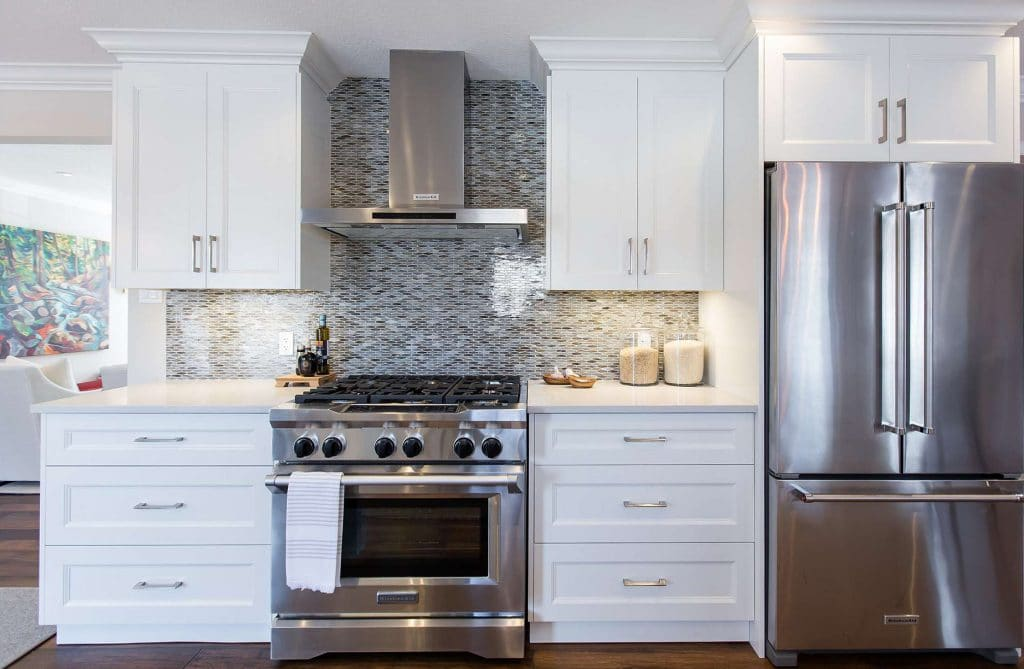 Kitchen featuring gas top stove and double door fridge with pull out freezer drawer