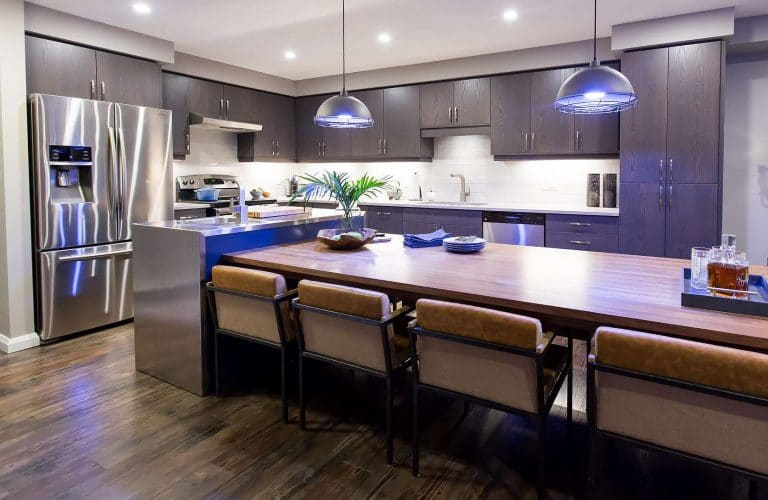 Kitchen with blue hanging industrial lights