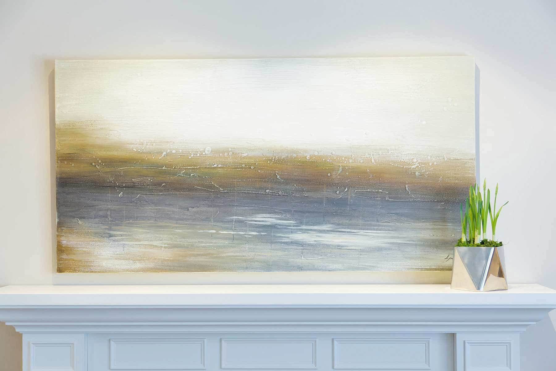 Fireplace mantel close-up featuring wood paneling and abstract landscape painting