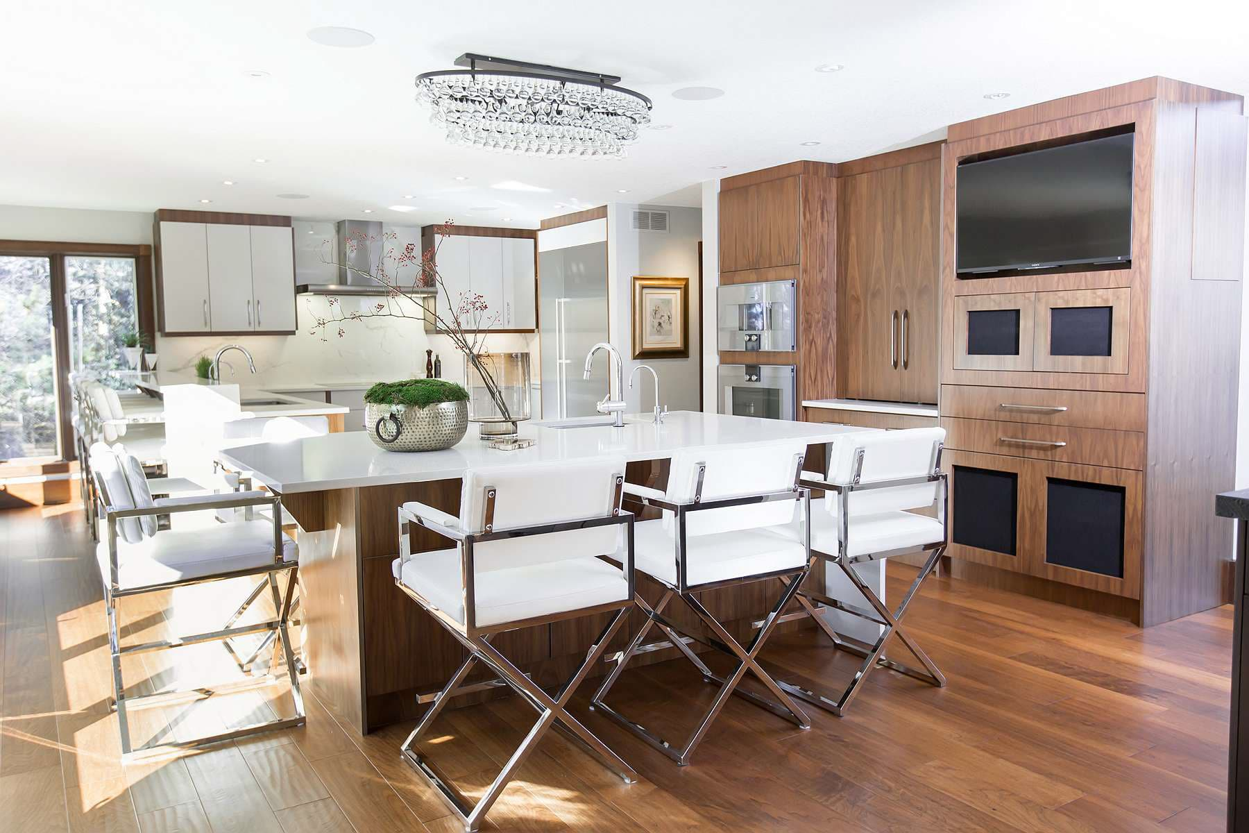 Kitchen featuring walnut cabinets with white doors and walnut doors, white quartz countertops and rustic finish walnut flooring