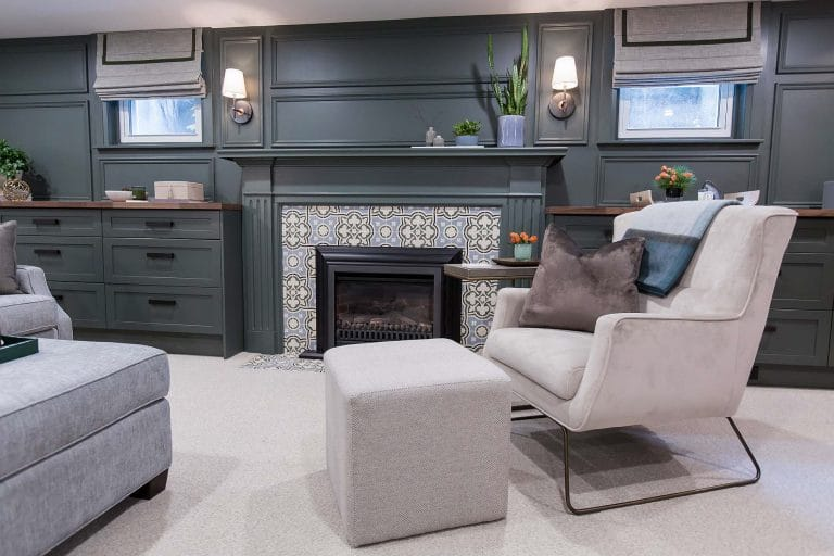 Pandora Crescent Basement Fireplace with Green and Blue Traditional Tile and Beige Velvet Arm chair with Ottoman Cube