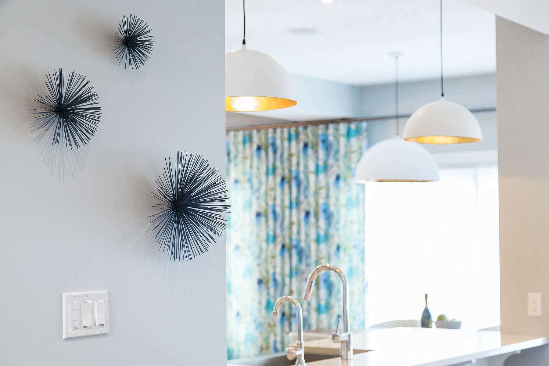Blue Sea Urchin Wall Decor, white and gold dome pendant light and amaya vintage linen drapes