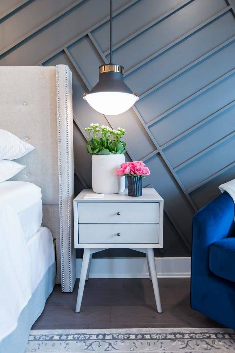 West Elm bedside table with Mateo ceiling-mounted pendant light and diagonal wall paneling in Benjamin Moore Flint.