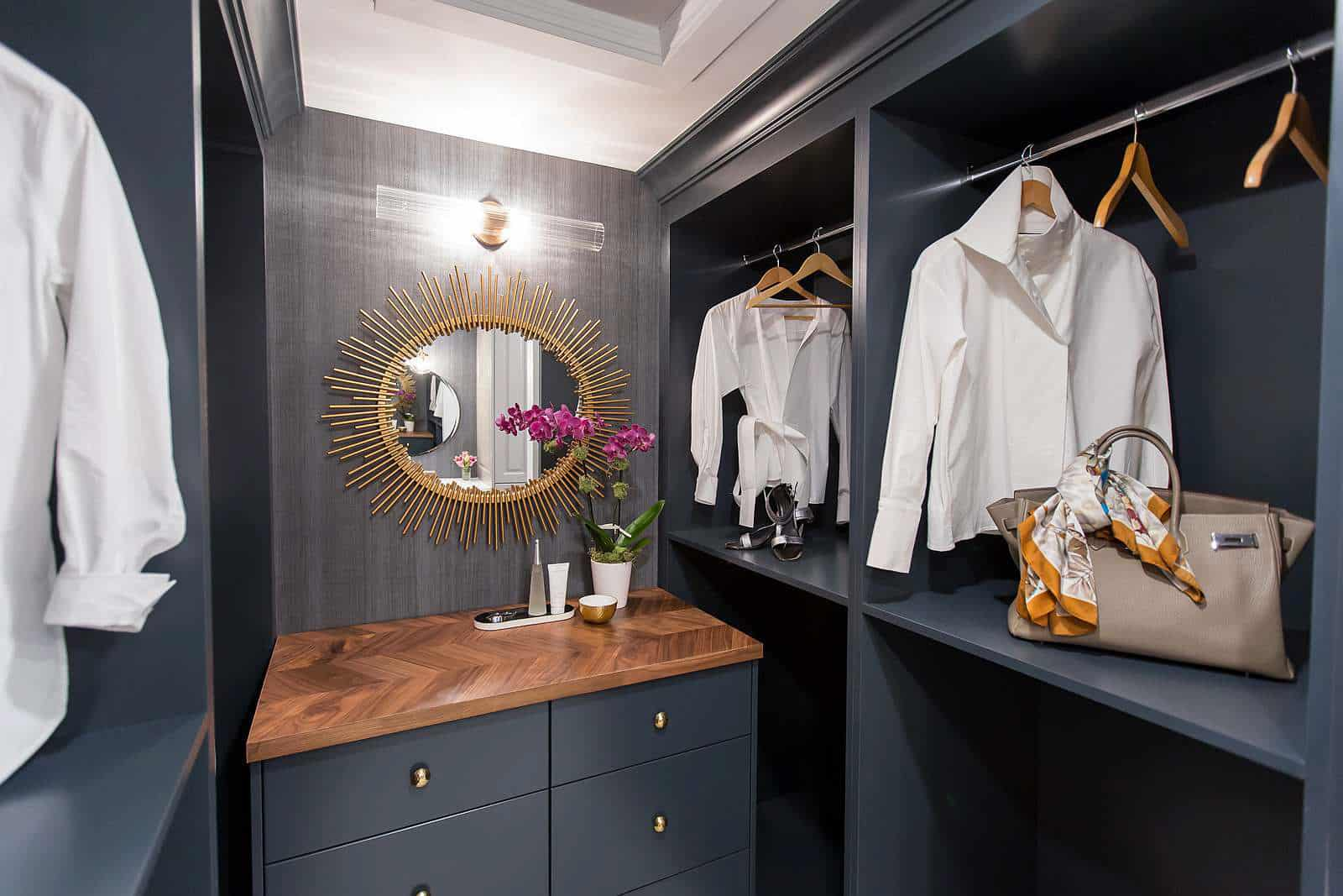 Master bathroom with custom built-in vanity in Benjamin Moore Storm, delta trinsic faucet in bronze, Mateo double globe black and brass wall sconce, soaker tub and geometric floor tile and custom upholstered bench blue wool striae and Woeller Group grasscloth wallpaper.