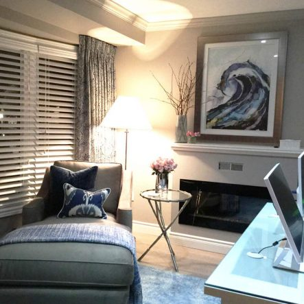 Office featuring divan with grey linen upholstery, fireplace, silk drapes and iMac computers